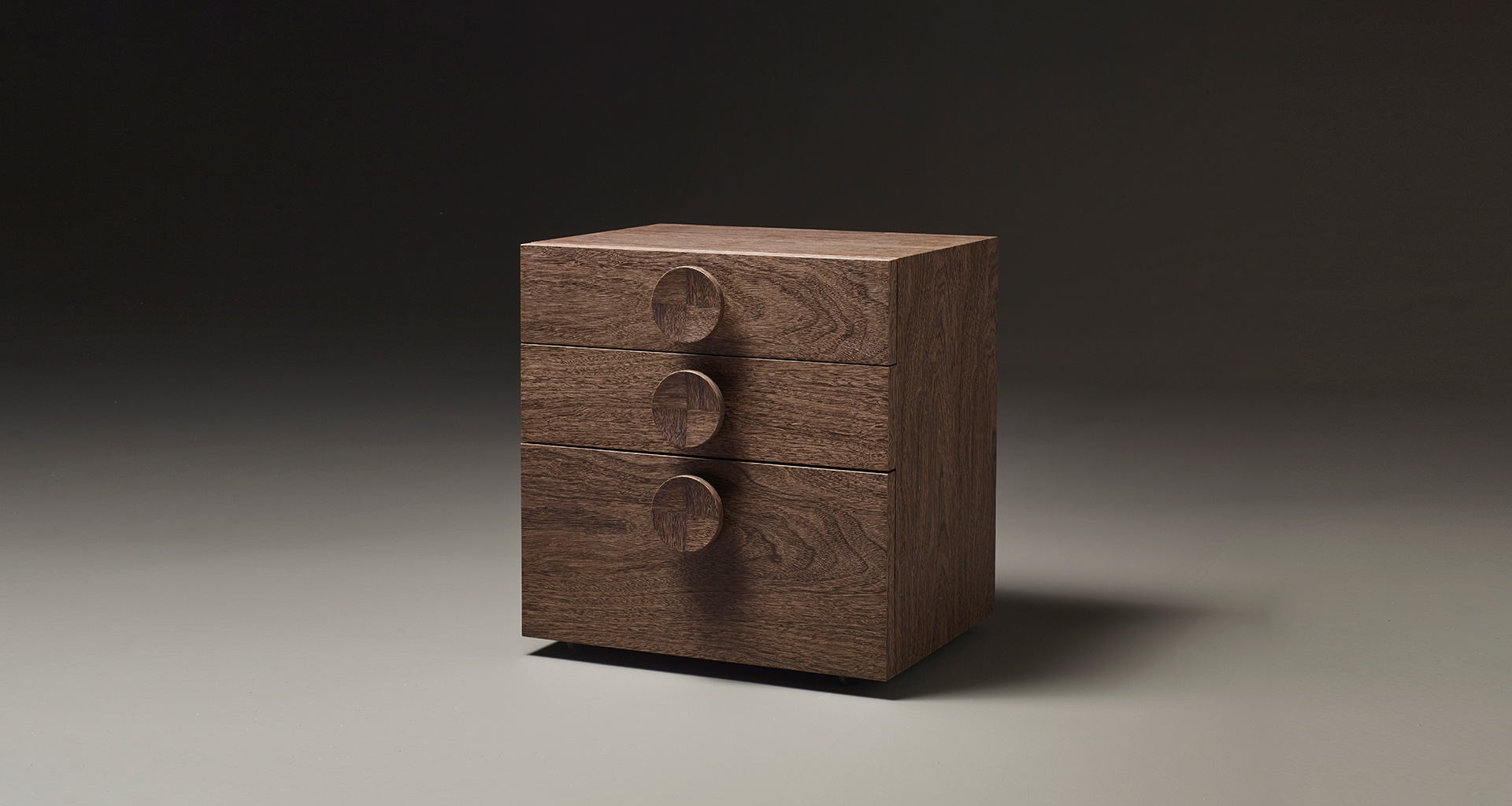 Dagoberto is a wooden bedside table with wheels and drawers from the Promemoria's catalogue | Promemoria