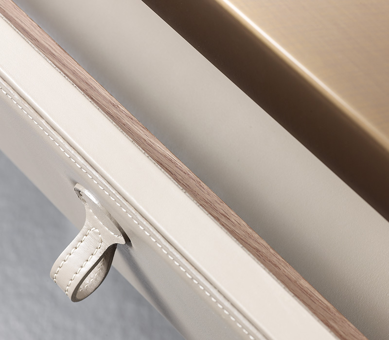 Drawer detail of Gong, a bronze bedside table that can be covered in fabric or leather, from the Promemoria's catalogue | Promemoria