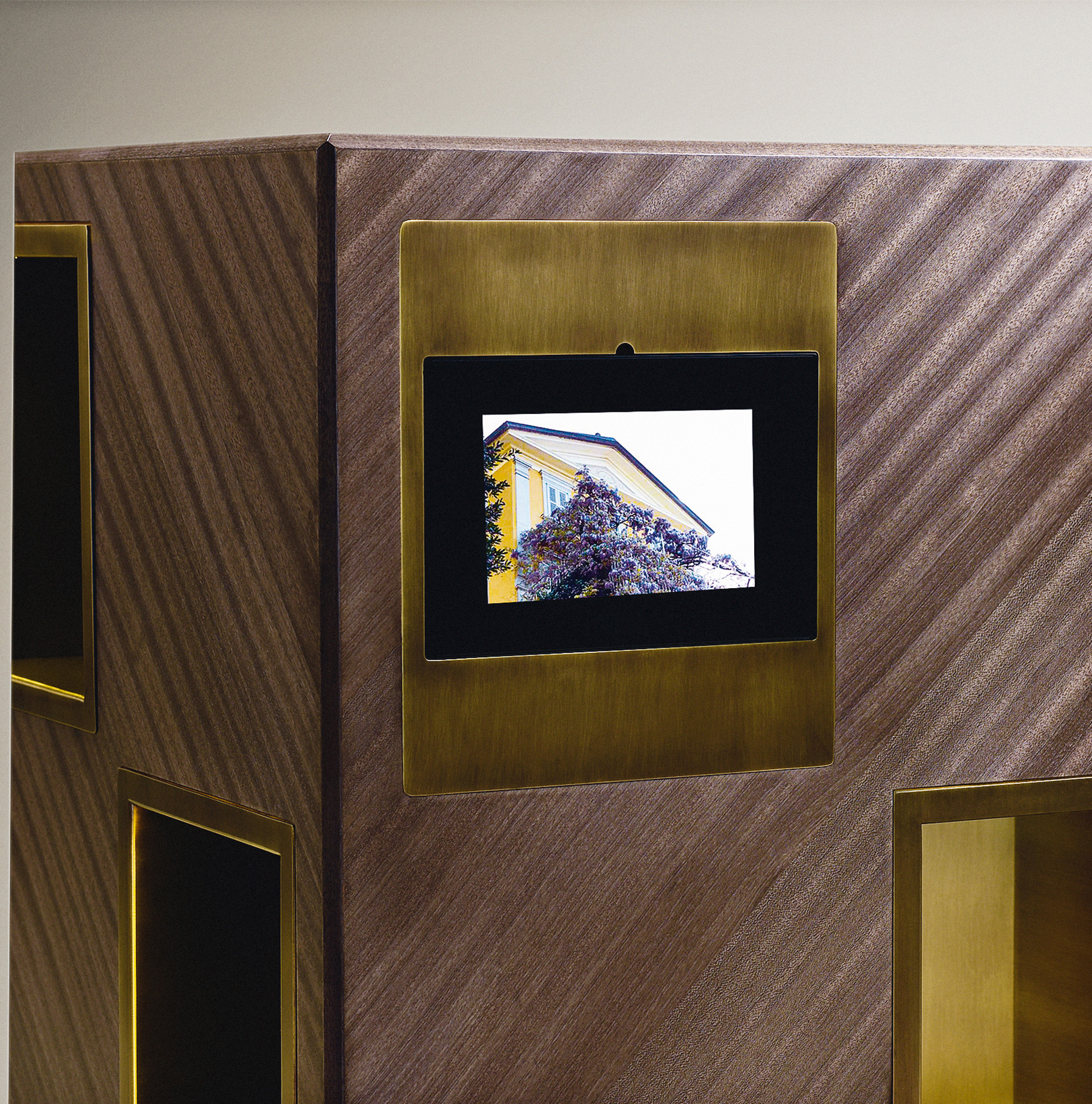 Detail of Meryl, a revolving wooden bookcase with bronze compartments from the Promemoria's catalogue | Promemoria