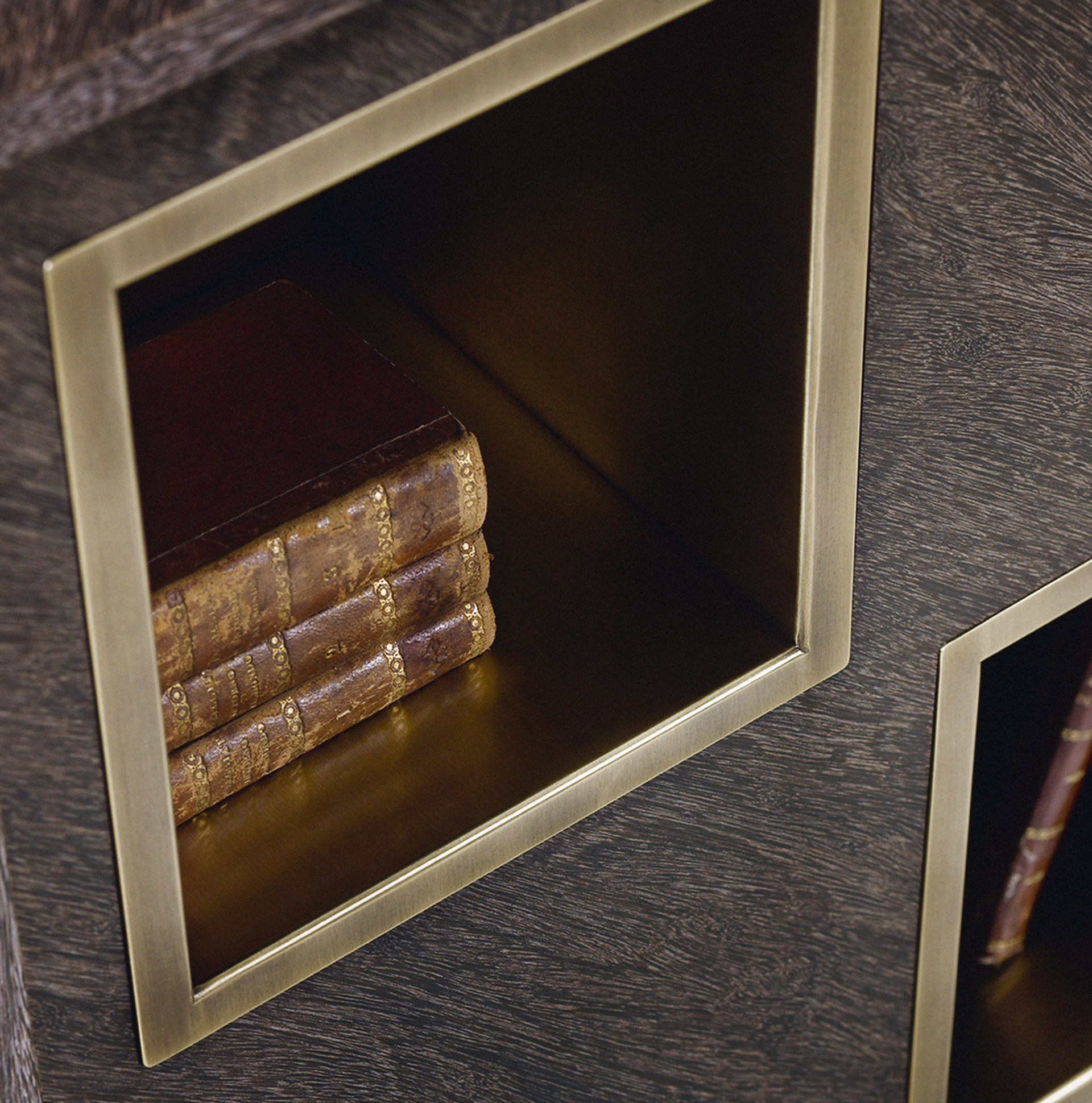 Detail of the bronze compartments of Meryl, a revolving wooden bookcase from the Promemoria's catalogue | Promemoria