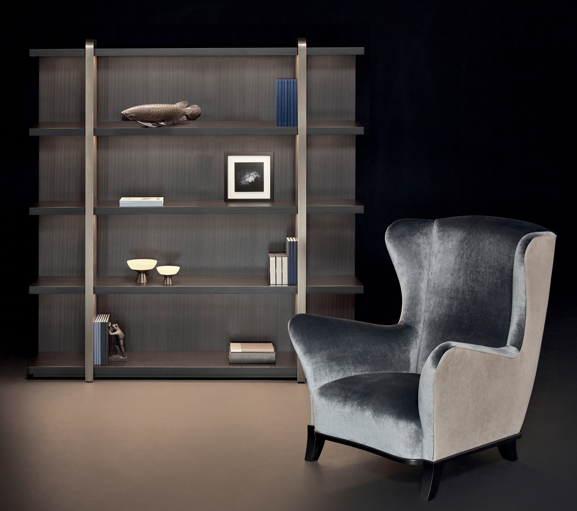 Detail of Nisha, a wooden bookcase with bronze supports from the Promemoria's Night Tales collection | Promemoria