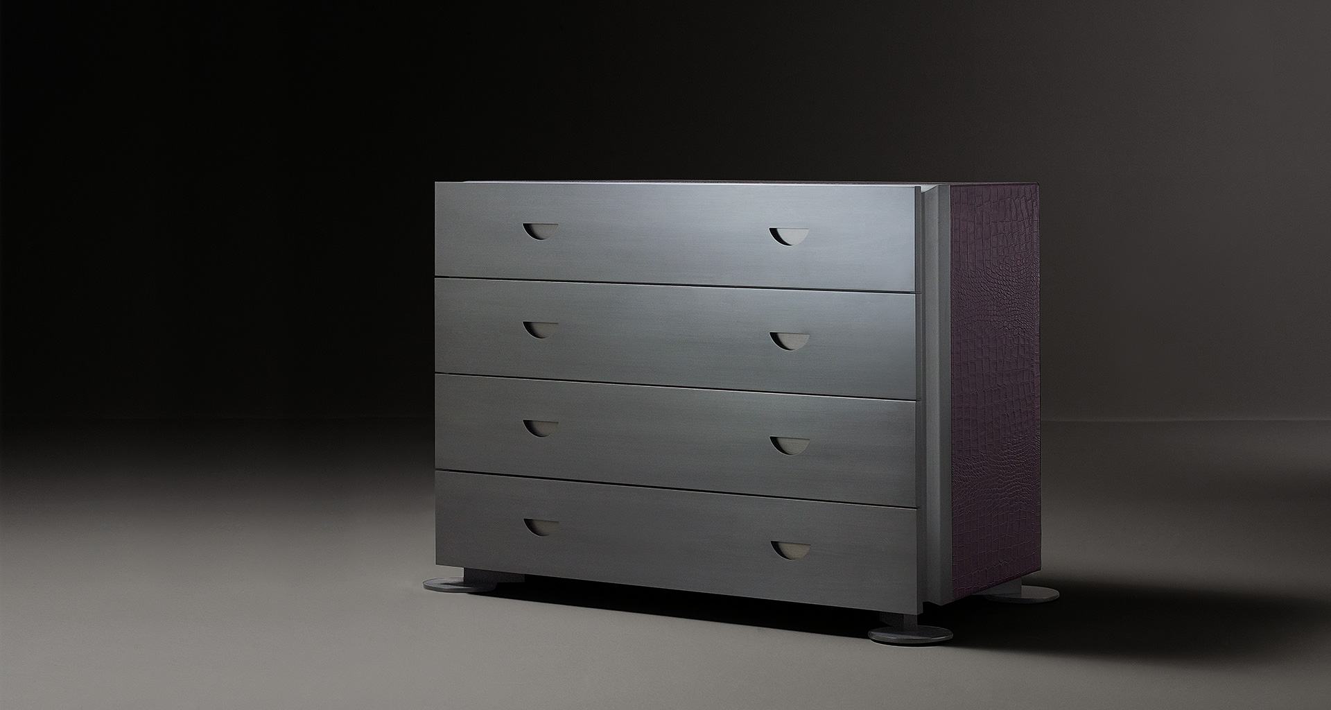 Dagoberto is a wooden chest of drawers with bronze feet and leather placemats from Promemoria's catalogue | Promemoria