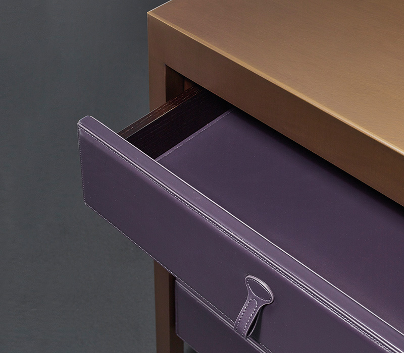 Drawer detail of Gong, a bronze chest of drawers covered in fabric or leather from Promemoria's catalogue | Promemoria