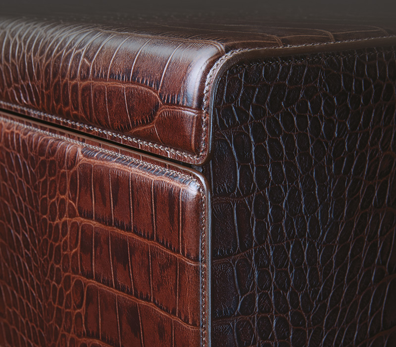 Detail of Orione, a wooden chest of drawers covered in leather, from Promemoria's catalogue | Promemoria