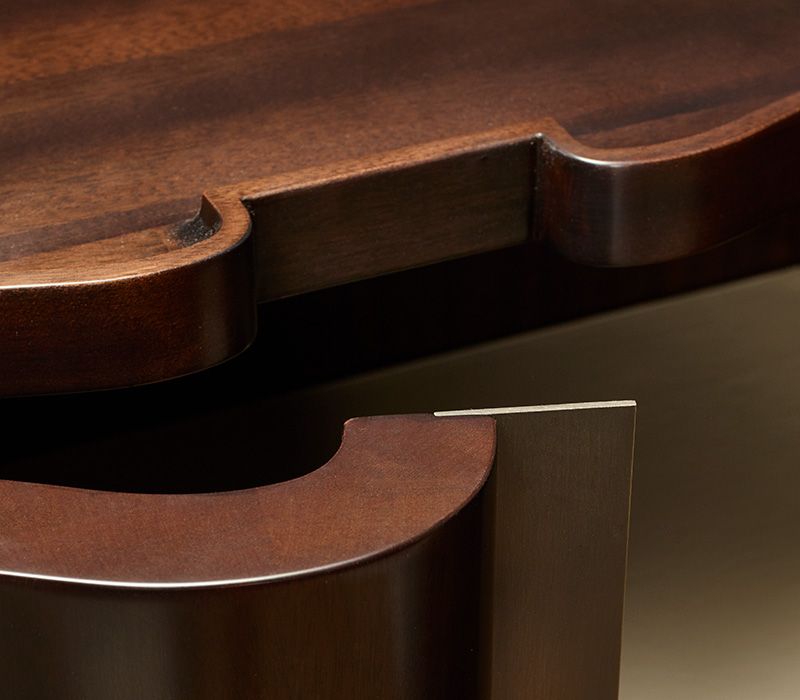 Bronze handle detail of Asterya, a wooden cabinet with bronze details and leather shelves, drawers and placemats from Promemoria's collection Amaranthine Tales | Promemoria