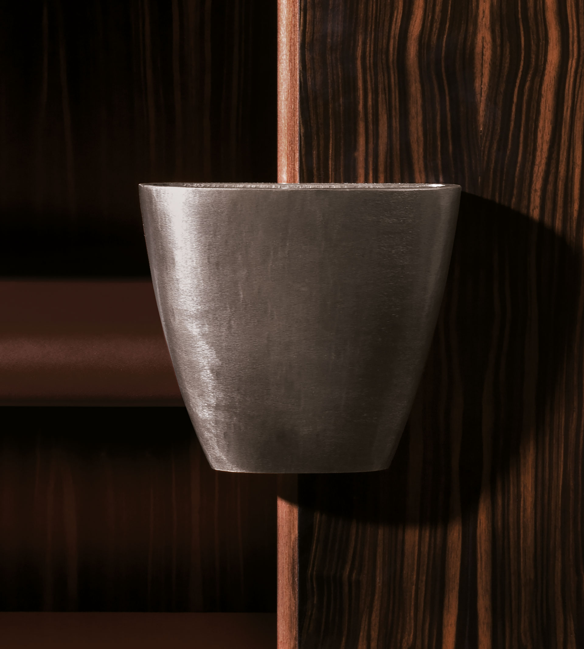 Bronze handle detail of Bonaventura, a wooden cabinet with bronze base, from Promemoria's catalogue | Promemoria