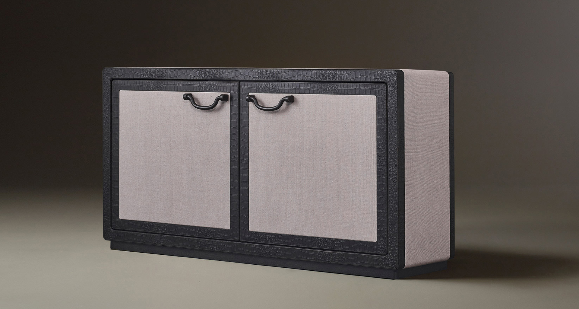 Future Voyager Atto II is a wooden cabinet covered in leather and fabric with handles and placemats in leather from Promemoria's catalogue | Promemoria