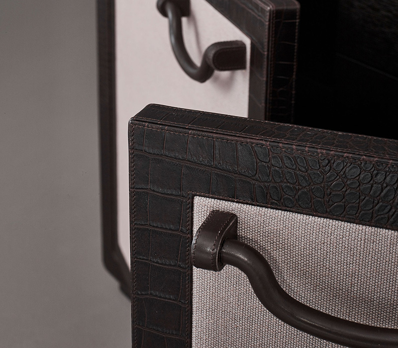Leather handle detail of Future Voyager Atto II, a wooden cabinet covered in leather and fabric with handles and placemats in leather from Promemoria's catalogue | Promemoria