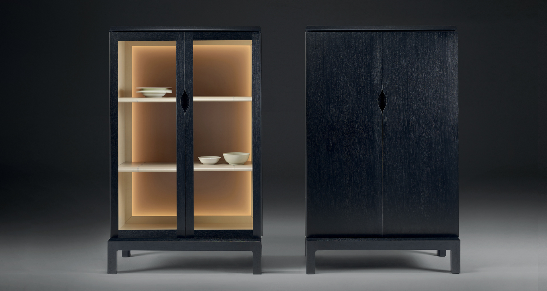 Laos is a wooden cabinet with a recessed handle and wooden or glass doors from Promemoria's Indigo Tales collection | Promemoria
