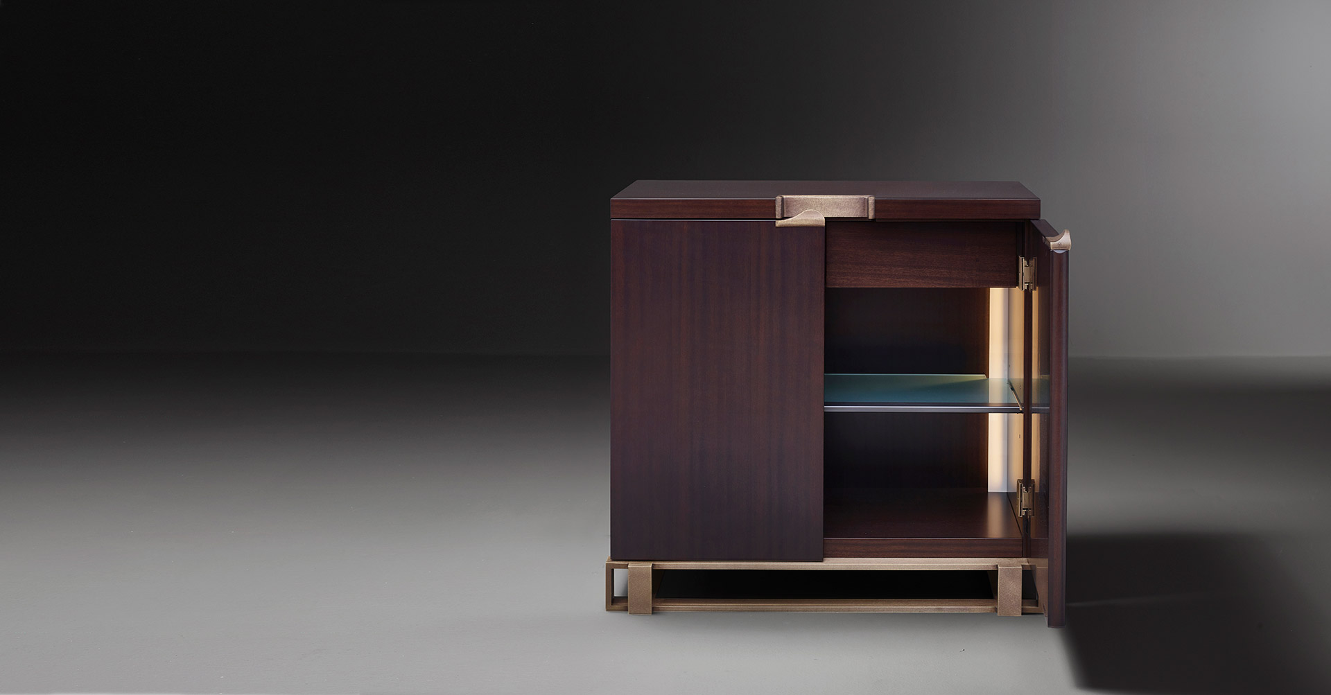 Inside of Margot, a wooden cabinet with bronze base, handle and hinges from Promemoria's catalogue | Promemoria