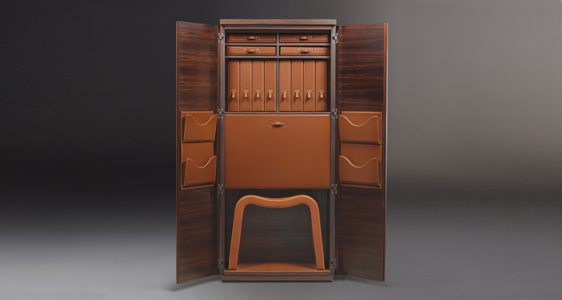 Inside of Stanley, a wooden cabinet with a bronze handle and internal modules covered in leather from Promemoria's catalogue | Promemoria