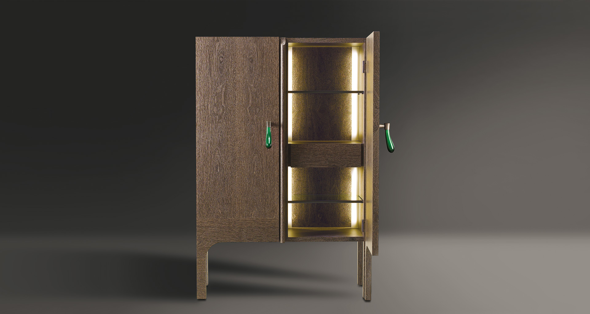Inside of Tom Bombadil, a wooden cabinet with bronze profiles and a Murano glass handle, from Promemoria's catalogue | Promemoria