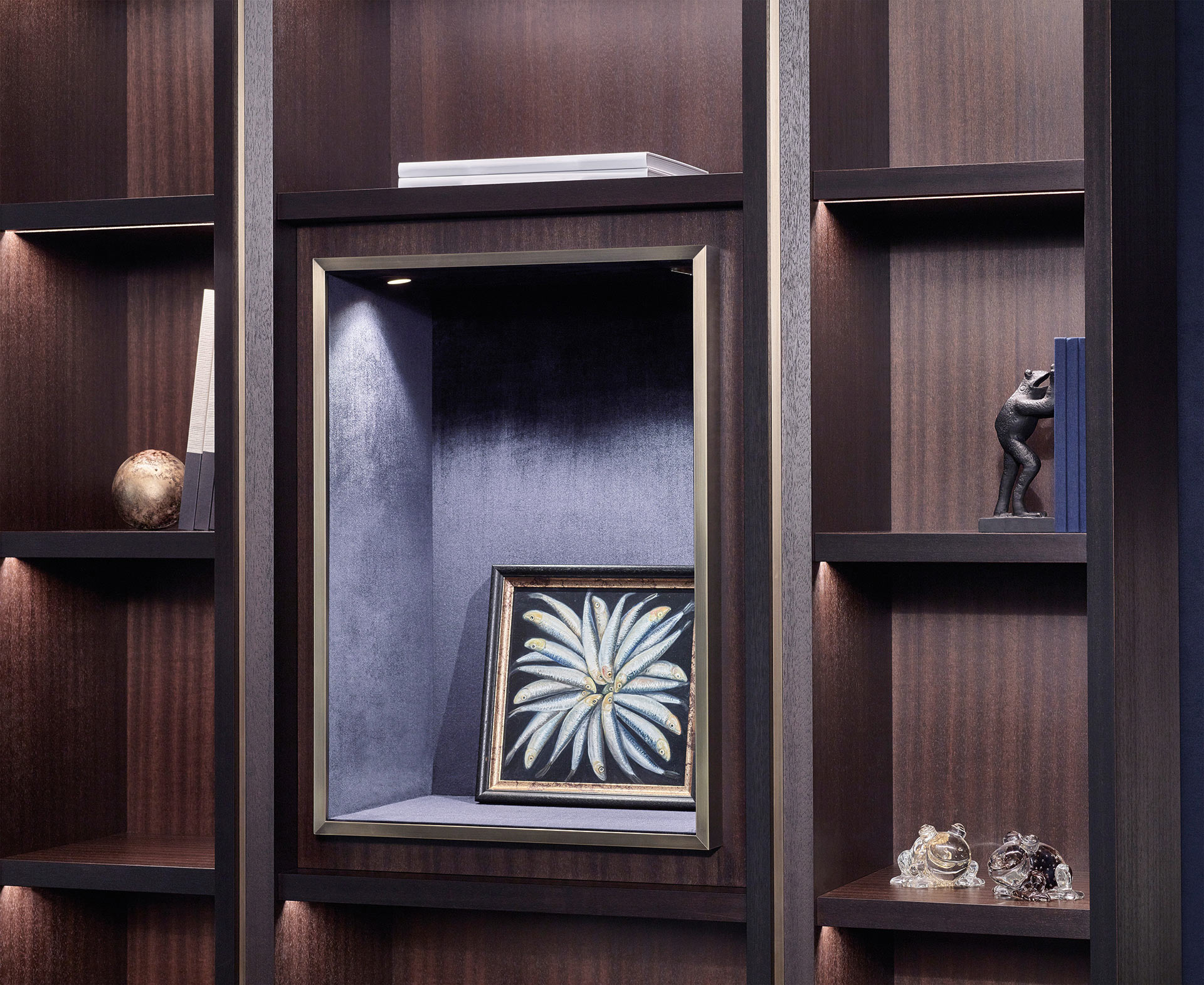 Detail of Nightwood, a wooden modular bookcase with bronze details, from Promemoria's Night Tales collection | Promemoria