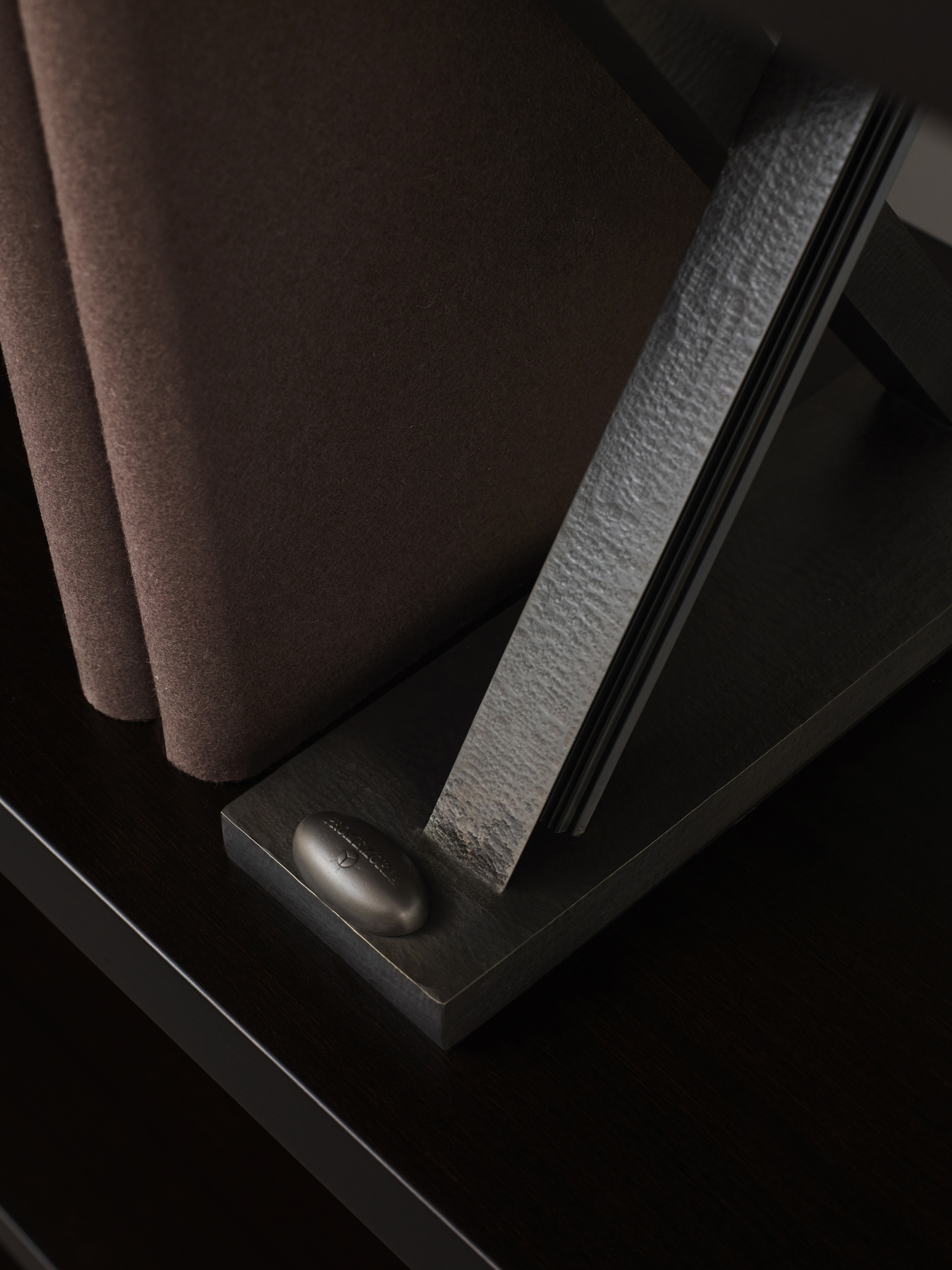 Detail of X Libreria, a wooden modular bookcase with bronze supports shaped like and X, from Promemoria's catalogue | Promemoria