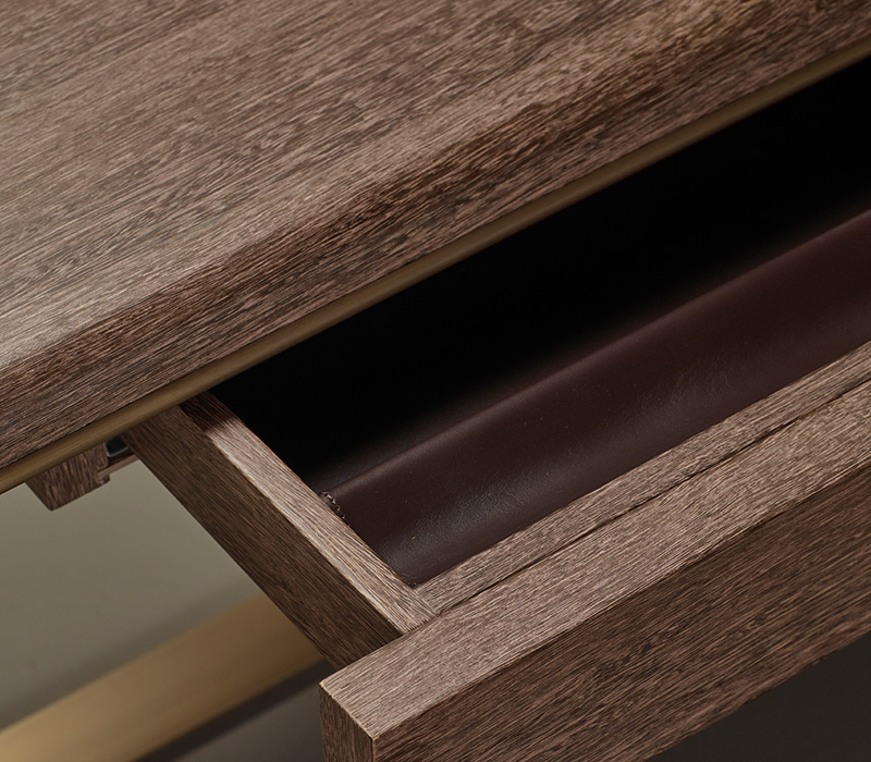 Detail of Galadriel, an essential writing desk with bronze structure and wooden tops and drawers from the Promemoria's catalogue | Promemoria