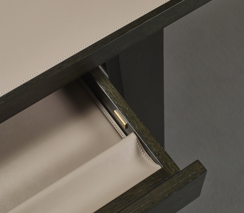 Detail of Isaac, a compact writing desk with wooden structure and drawers that belongs to the Amaranthine Tales collection of Promemoria | Promemoria