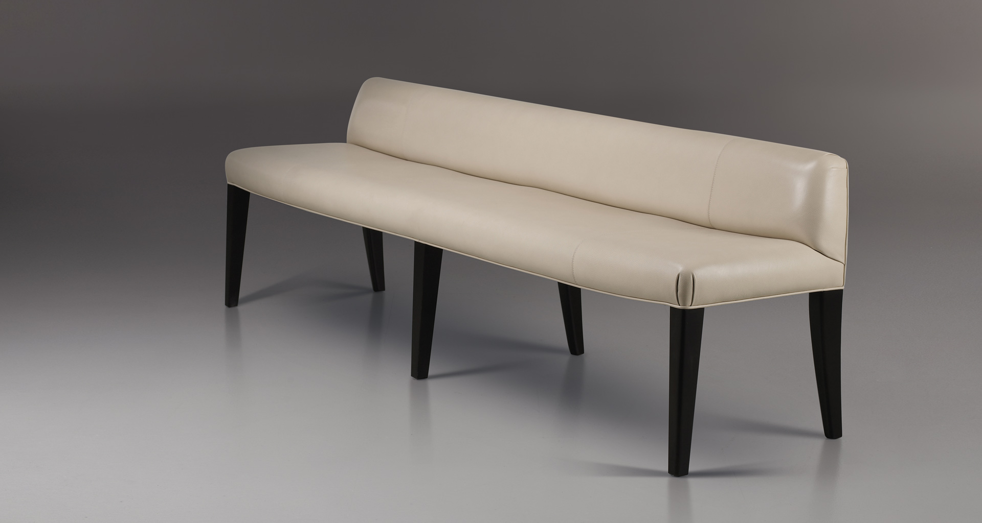 Isotta is a wooden bench with fabric or leather seat and back, from Promemoria's catalogue | Promemoria