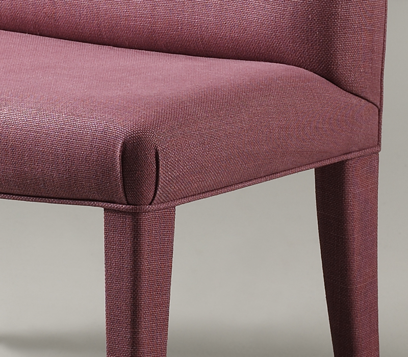 Detail of Isotta, a wooden bench with fabric or leather seat and back, from Promemoria's catalogue | Promemoria