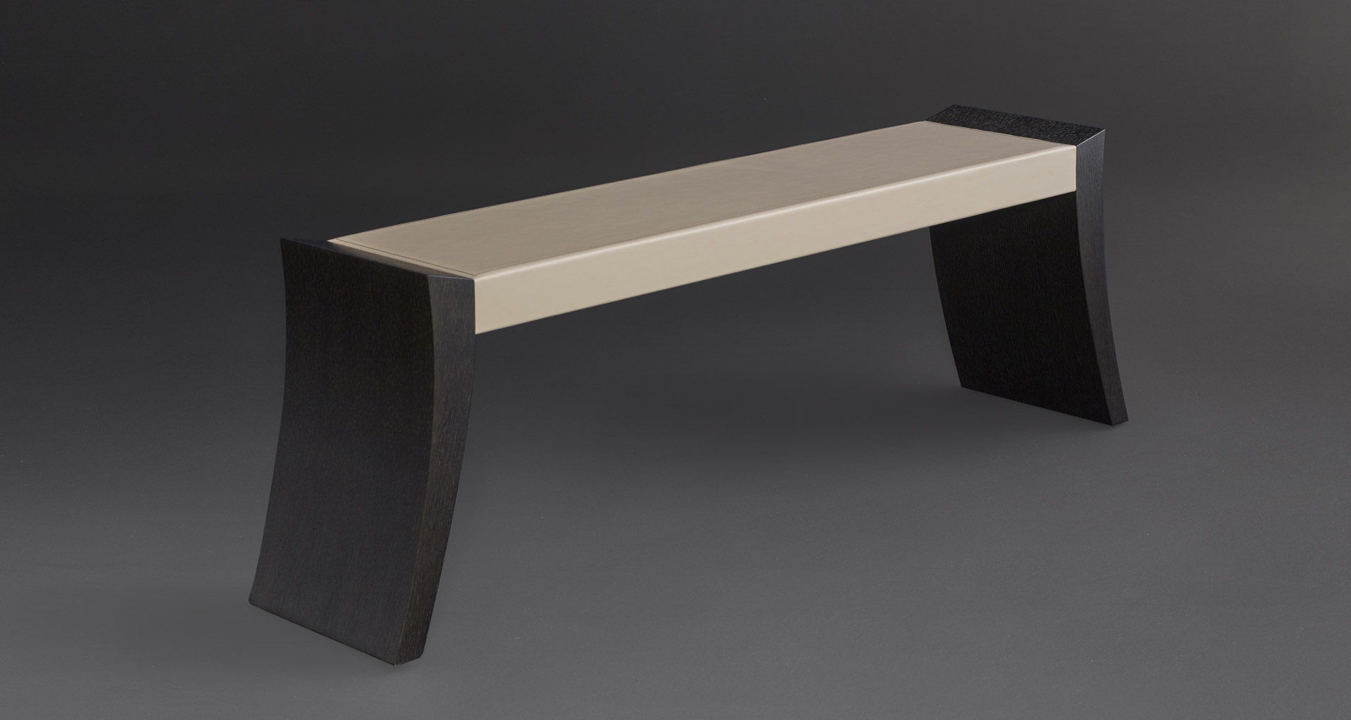 Saphire is a wooden bench, available with leather or galuchat top, from Promemoria's catalogue | Promemoria