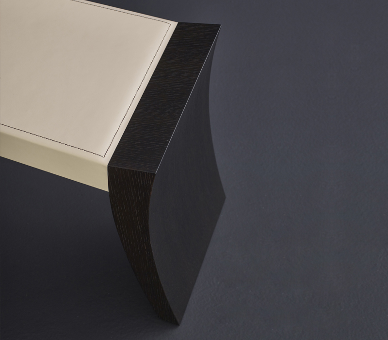 Detail of Saphire, a wooden bench, available with leather or galuchat top, from Promemoria's catalogue | Promemoria