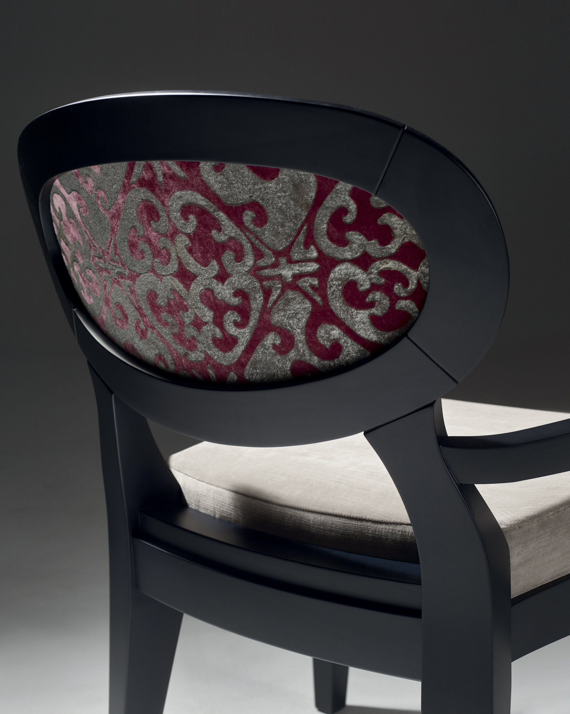 Back detail of Anima, a wooden and fabric or leather dining chair available with different combinations of fabrics and colors, from Promemoria's catalogue | Promemoria