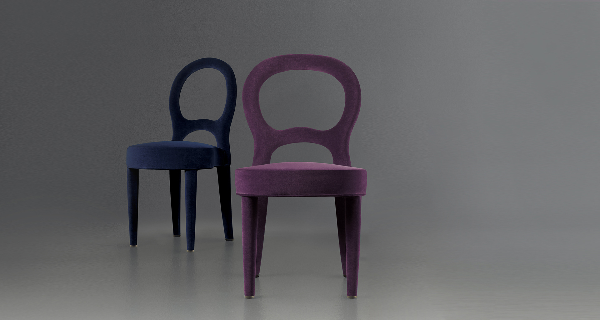 Different versions of Bilou Bilou, a dining chair covered in velvet and linen or nappa leather available in different colors and in the versions standard, large and kids. Bilou Bilou is the most iconic dining chair from Promemoria's catalogue | Promemoria