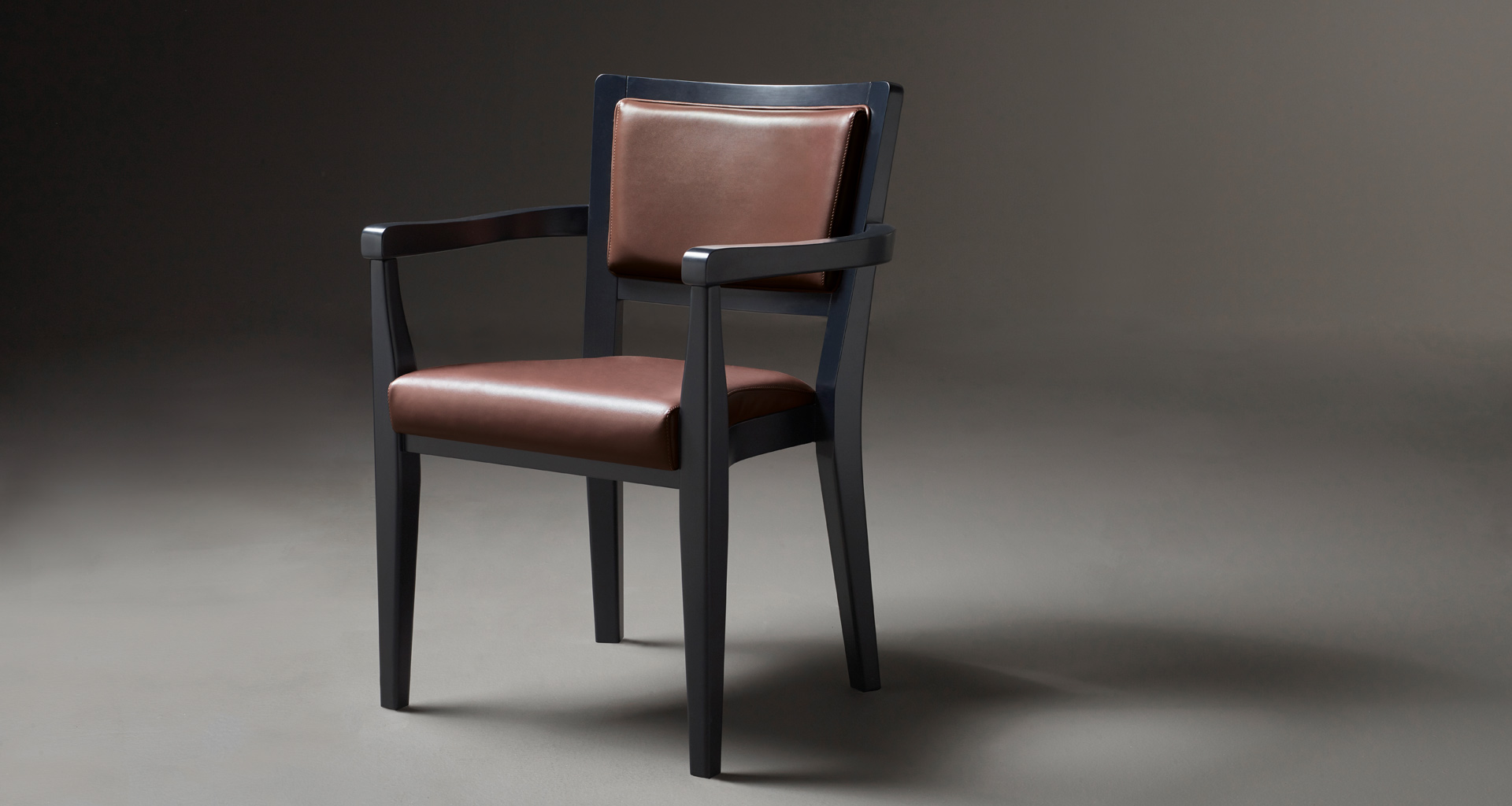 Bistrot is a wooden dining chair, with armrests and fabric or leather seat and back, from Promemoria's catalogue | Promemoria