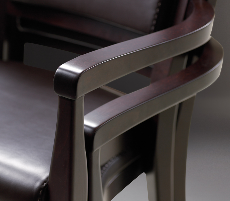 Detail of stacked Bistrot chairs, wooden dining chairs, with armrests and fabric or leather seat and back, from Promemoria's catalogue | Promemoria