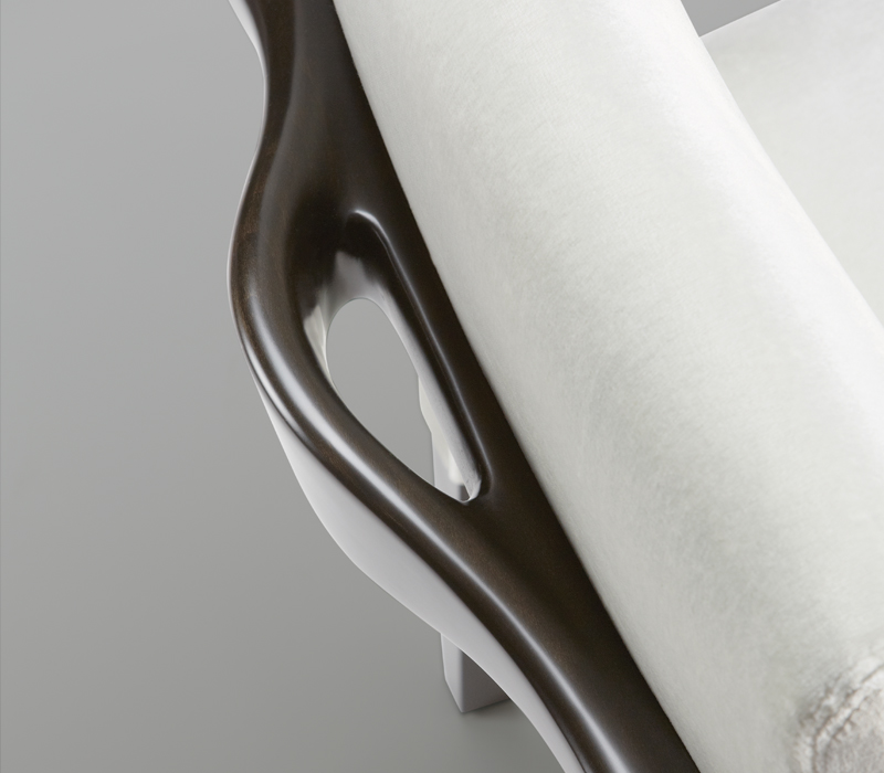 Handle detail of Brigitta Short, a wooden dining chair covered in fabric or leather, from Promemoria's catalogue | Promemoria