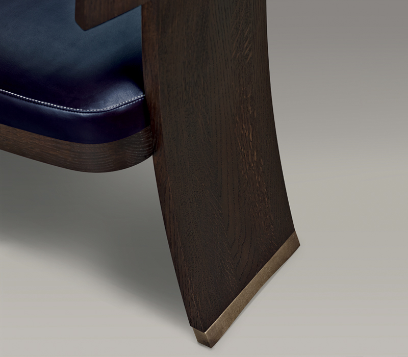 Bronze feet detail of DC Chair, a wooden dining chair with leather seat and back, from Promemoria's The London Collection | Promemoria