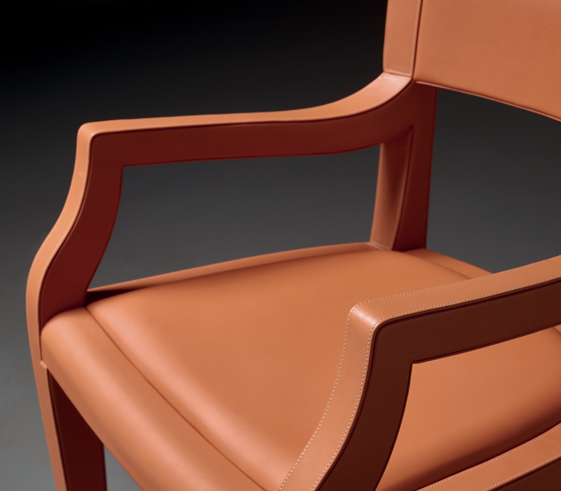 Low-back detail of Eloise, a wooden dining chair with leather seat, available with or without armrests and high or low-backed, from Promemoria's catalogue | Promemoria