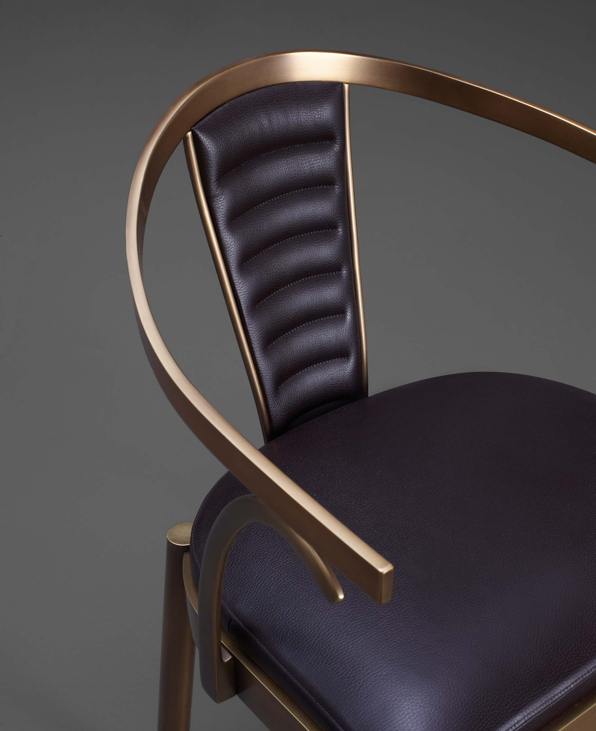 Detail of Jasmine, a bronze dining chair with armrests covered in leather, from Promemoria's catalogue | Promemoria