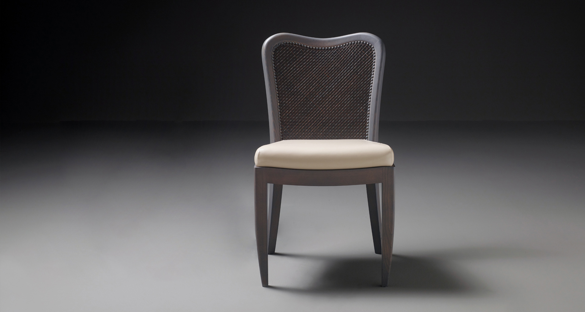Panama is a wooden chair with leather rope back that can be customized, from Promemoria's catalogue | Promemoria
