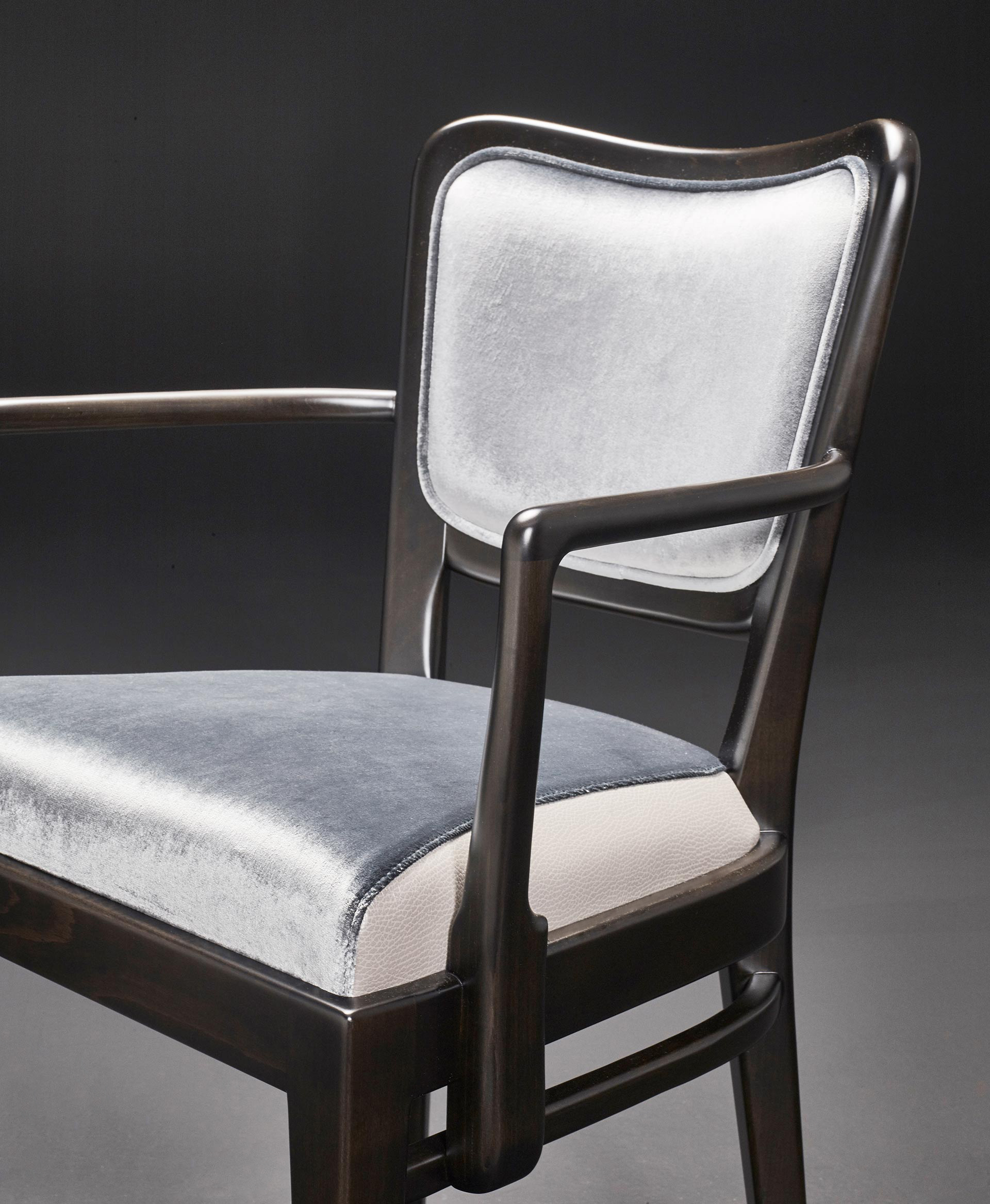 Detail of Pepita, a wooden dining chair with fabric or leather seat, from Promemoria's catalogue | Promemoria