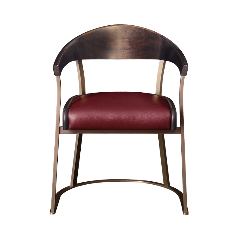 Rachele is a bronze chair with arms with wooden or leather back and leather seat, from Promemoria's catalogue | Promemoria