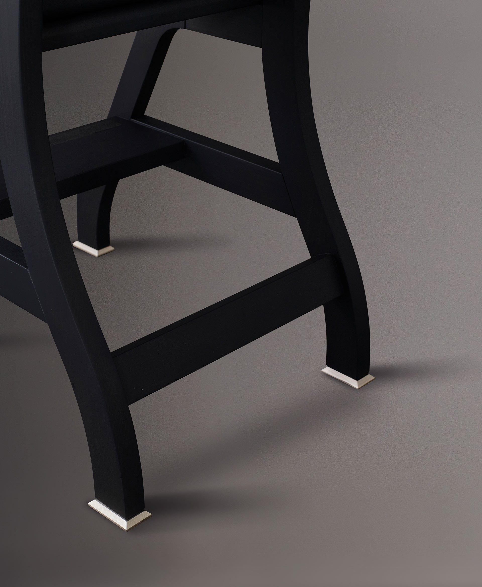 Bronze feet detail of Rebecca is a wooden convertile ladder-chair, from Promemoria's catalogue | Promemoria