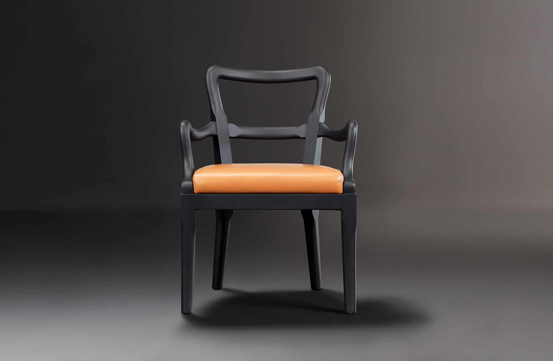 Sofia is a wooden dining chair with fabric or leather seat and with armrests, from Promemoria's catalogue | Promemoria