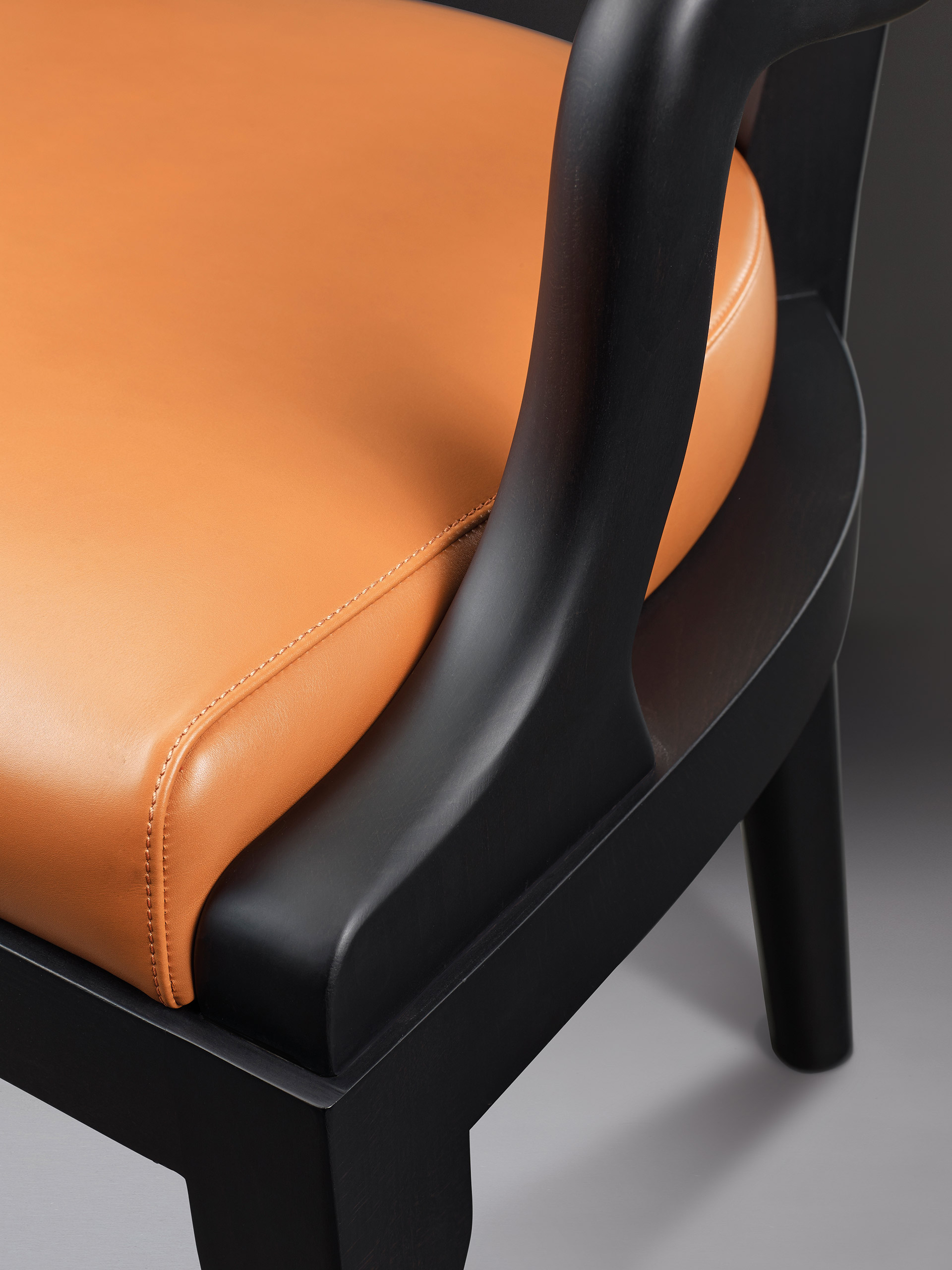 Detail of Sofia, a wooden dining chair with fabric or leather seat and with armrests, from Promemoria's catalogue | Promemoria