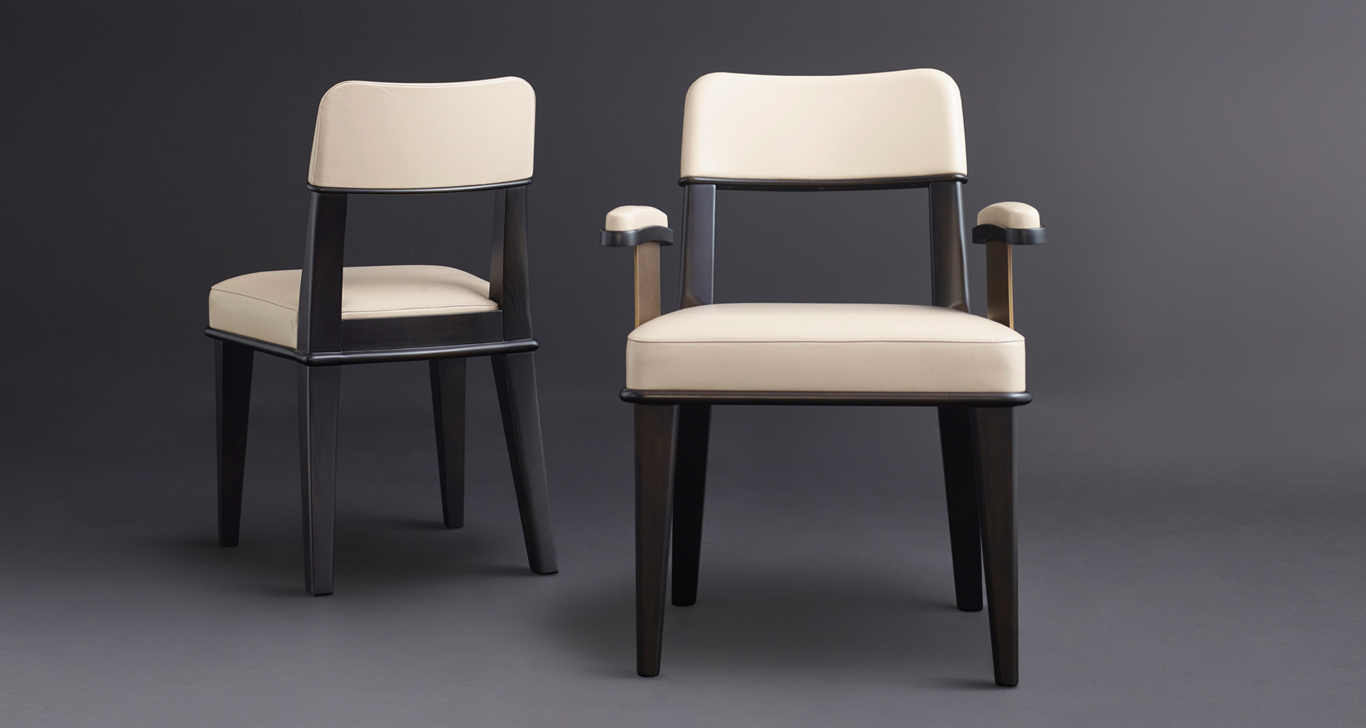 Vespertine is a wooden dining chair with leather seat and back and with or without armrests with bronze details, from Promemoria's Night Tales collection | Promemoria