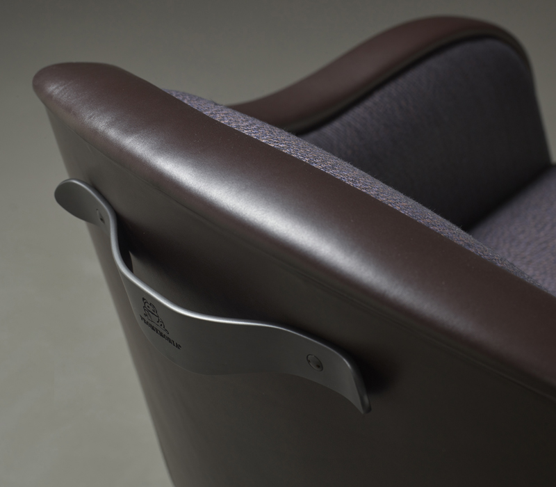 Bronze handle detail of Vittoria, a wooden chair covered in fabric or leather, from Promemoria's catalogue | Promemoria