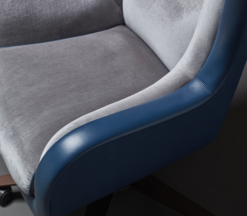 Detail of Butterfly, an office armchair covered in leather and fabric, available with a pouf, from Promemoria's catalogue | Promemoria