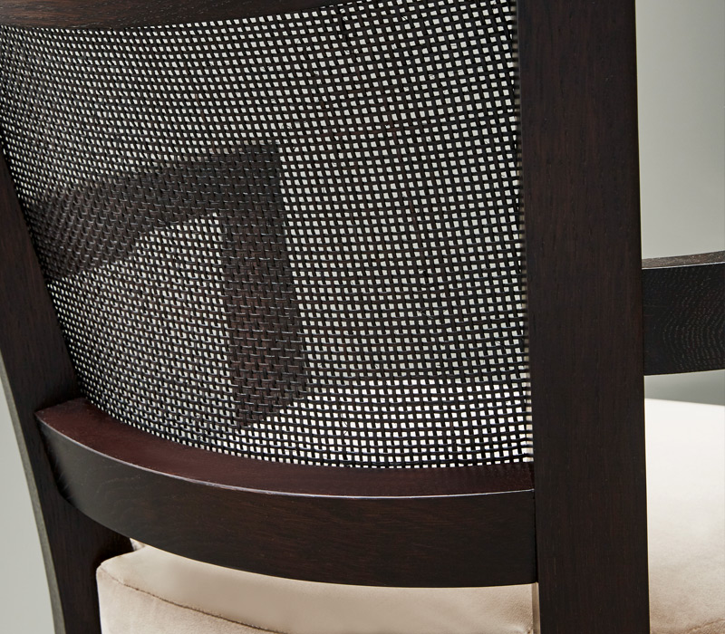 Straw back detail of Caffè, a wooden office chair with fabric or leather seat, from Promemoria's catalogue | Promemoria