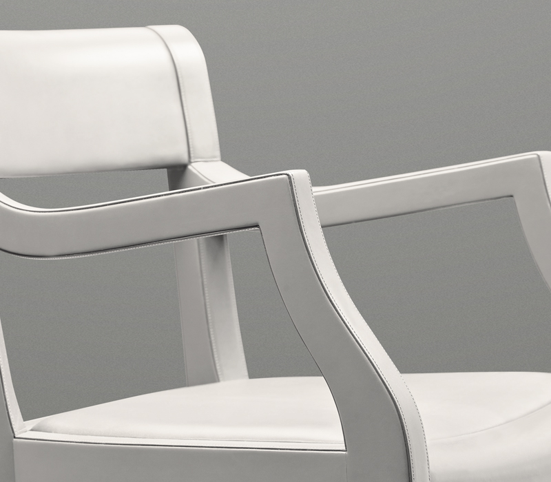 Detail of Eloise, a wooden office chair with or without armrests and leather seat, from Promemoria's catalogue | Promemoria