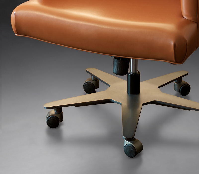 Metal base detail of Isotta, an office chair with or without armrests covered in fabric or leather, from Promemoria's catalogue | Promemoria