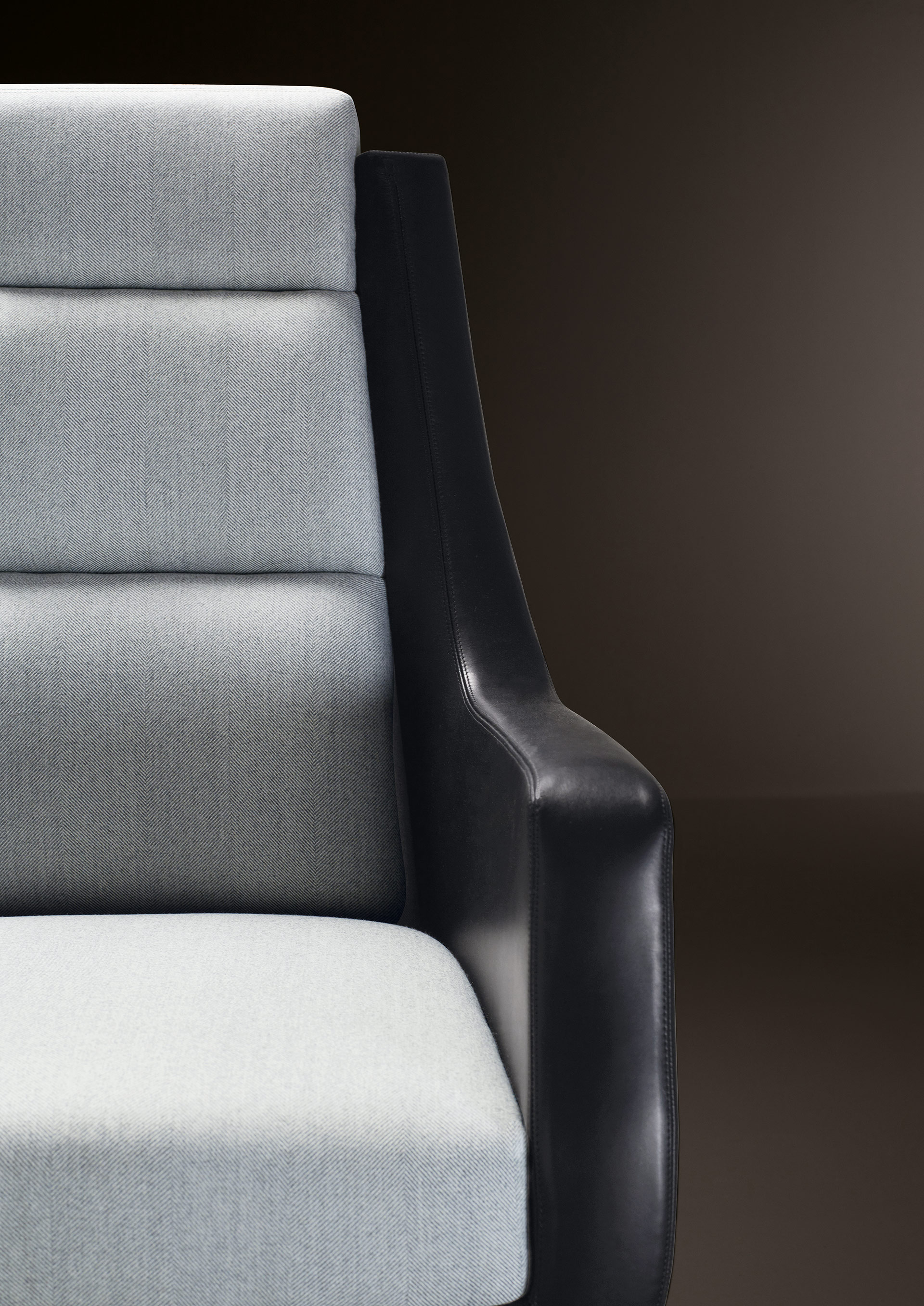 Detail of Kate, an office chair with a metal base covered in leather and fabric, from Promemoria's Amaranthine Tales collection | Promemoria