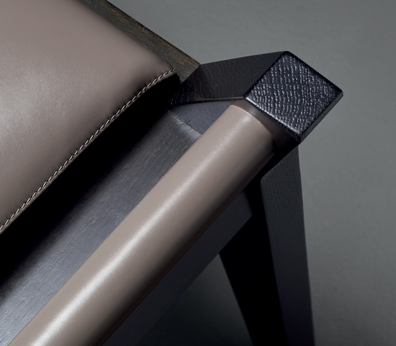 Detail of Jean, a wooden stool, leather seat, upholtery and handles, from Promemoria's Amaranthine Tales collection | Promemoria