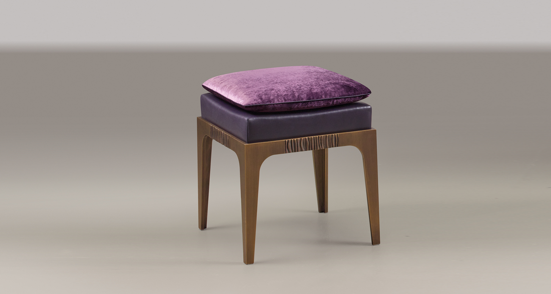 Montagu is a bronze stool with leather seat and fabric cushion, from Promemoria's The London Collection | Promemoria