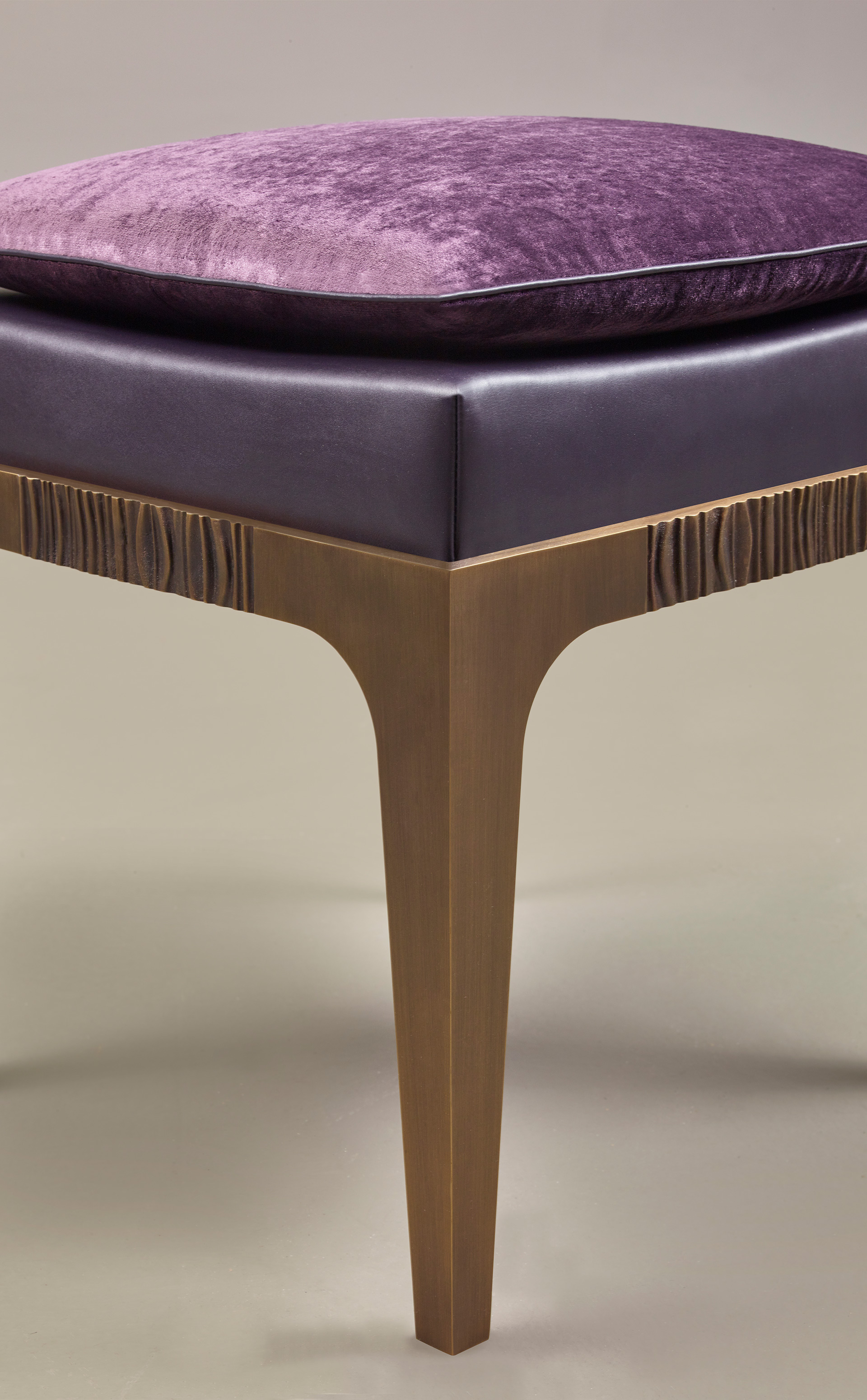 Detail of Montagu, a bronze stool with leather seat and fabric cushion, from Promemoria's The London Collection | Promemoria