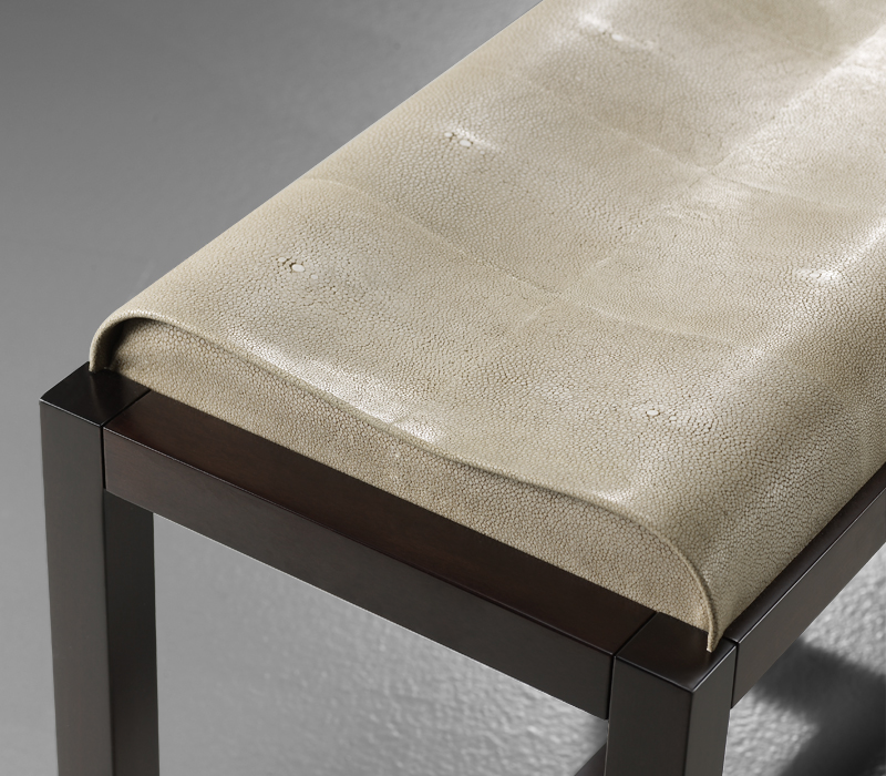 Detail of Pierre, a wooden stool with seat covered in leather or galuchat, from Promemoria's catalogue | Promemoria