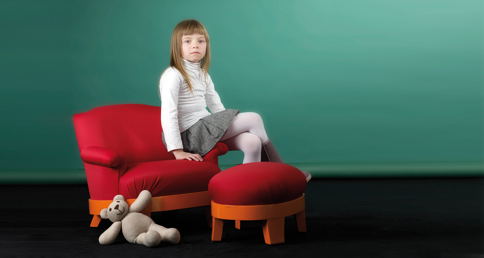 Gacy Kids is a children's version of the iconic armchair with a pouf, part of the Promemoria's catalogue | Promemoria